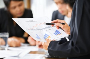 business growing pains - people examining graphs